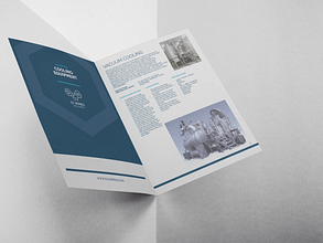 open booklet brochure against a gray background with DC Norris North America Logo on the navy blue cover and the imagery and specifications about the vacuum cooling equipment on the opposing page