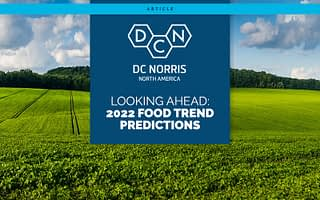 blue sky and rolling green fields behind a headline that reads: Looking Ahead: 2022 Food Trend Predictions