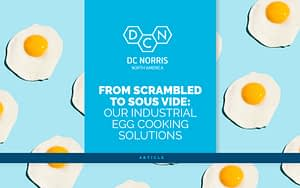 over easy eggs on a bright blue background with an article headline that reads 'from scrambled to sous vide: our industrial egg cooking solutions