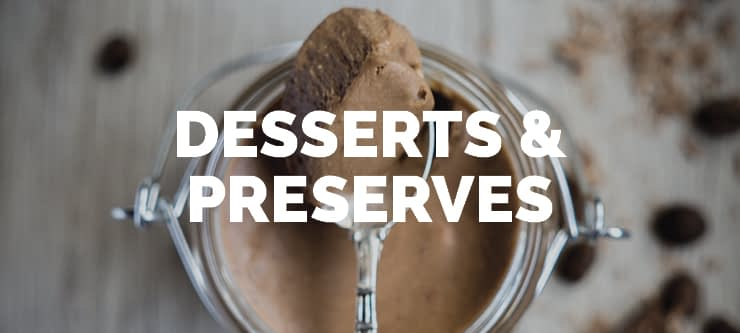 chocolate mousse in a glass jar with a spoon full on top showcasing the type of products that the equipment DC Norris North America sells can manufacture in the desserts and preserves category