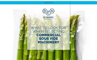 bright green, fresh asparagus sealed in a vacuum pouch on a white background behind a headline that reads: What to Look for When Selecting Commercial Sous Vide Machinery. The headline appears below the DC Norris North America logo