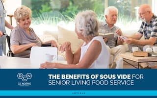 """a group of content seniors in a communal living space at a senior living facility. Below the image is the DC Norris North America logo and a headline that reads 'The Benefits of Sous Vide for Senior Living Food Service"""""""