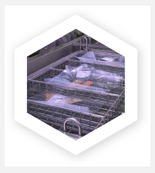 Industrial sous vide water bath cooking salmon in sealed pouches