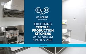 exploring central production kitchens & equipment as minimum wages rise title against a blue background and the picture of a commercial kitchen behind it