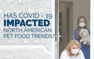 "a photo of a mother, child and their dog wearing medical masks during the COVID-19 pandemic retrieving a delivery of food and supplies fro their front porch. The image reads ""Has COVID-19 Impacted North American Pet Food Trends?"" and links to a blog post by DC Norris North America"