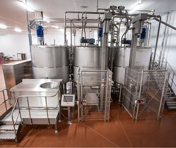 a photograph of DC Norris North America's wet pet food manufacturing equipment setup on the factory floor
