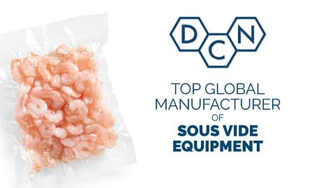 a vacuum sealed bag of shrimp ready to be cooked in a sous vide tank manufactured by DC Norris North America sits next to the announcement that DC Norris & Company has been named a top global manufacturer of sous vide equipment